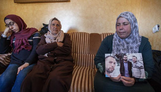 Palestinian mother mourns her son in West Bank village of Al-Walajah