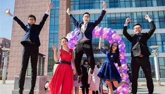 Students cheer at adult ceremony in north China