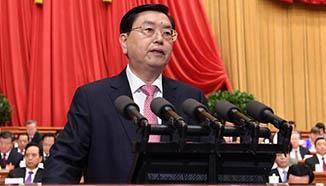 Zhang Dejiang delivers work report of NPC Standing Committee