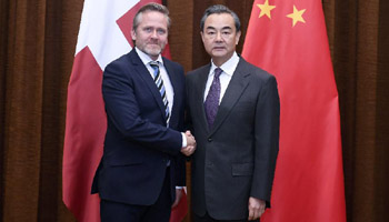 Chinese FM holds talks with Danish counterpart in Beijing