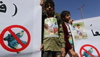 Children protest against carrying weapons, firing in air in Yemen