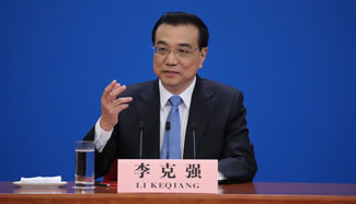 In pics: Chinese Premier Li Keqiang meets the press