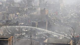Devastating fire guts hundreds of shanties in Bangladesh capital