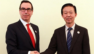 China, U.S. finance chiefs meet for first time, vow more cooperation