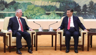 President Xi meets U.S. Secretary of State