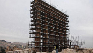 Workers prepare for maintenance work at complex of temples in Lebanon