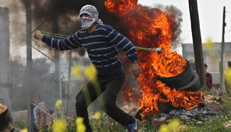 Palestinian protesters clash with Israeli soldiers in Kufr Qadoom village