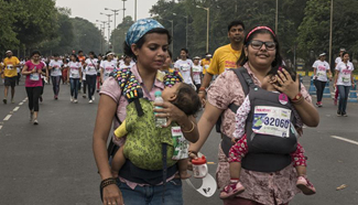 People participate in Pinkathon in Kolkata, India