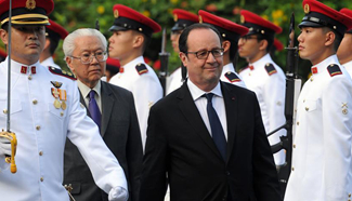 Singapore's president and French counterpart attend welcome ceremony in Singapore