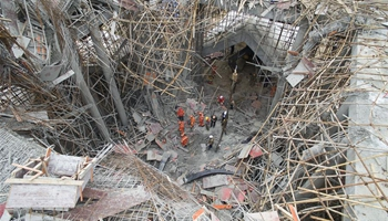 Two dead, seven trapped in central China's scaffold collapse