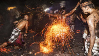 Men take part in sacred battle of fire before Nyepi in Indonesia