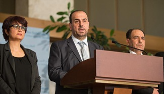 Syria's opposition delegation leader holds press conference in Geneva