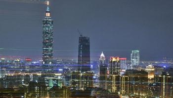 Colored lights illuminate downtown Taipei