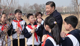 Xi attends tree planting activity, calls for understanding, protecting nature