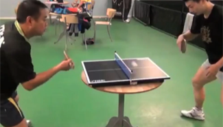 Rare showdown: China's Olympic champions battle it out on mini tennis table