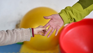 Teachers join in rehabilitation program to help autistic children in N China