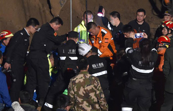 Child lifted from 15-meter deep well in east China