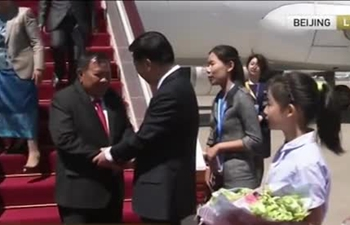 Laos president arrives in Beijing for Belt and Road Forum
