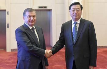 Zhang Dejiang meets Uzbek President Shavkat Mirziyoyev in Beijing