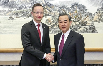 Chinese FM Wang Yi meets with Hungarian counterpart in Beijing