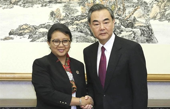 Chinese FM meets Indonesian, Greek counterparts in Beijing