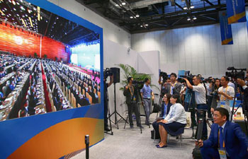Reporters gather to watch opening cermeony of Belt and Road forum