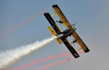 Aerobatics aircraft perform at air show in C China's Henan