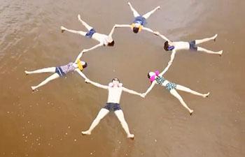 "Floating on China's ""dead sea"", at sea salt park in Dalian, China"