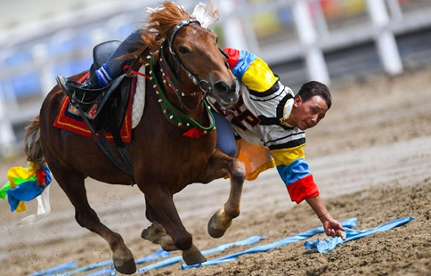 Horse riders perform during Shoton Festival in Lhasa