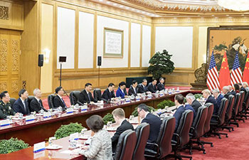 Xi holds talks with Trump