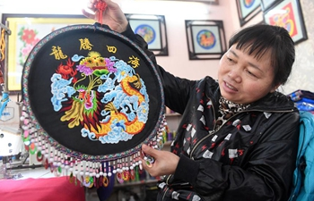 Intangible cultural heritage: colored embroidery of Zhuang ethnic group