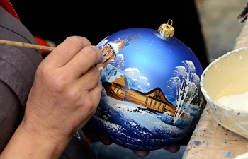 "People make Christmas tree decorations at ""Ariel"" factory in Russia"