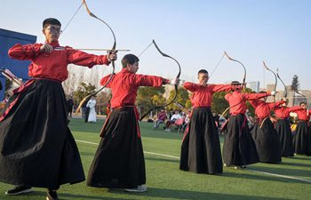 University students perform traditional ritual of archery in Anhui