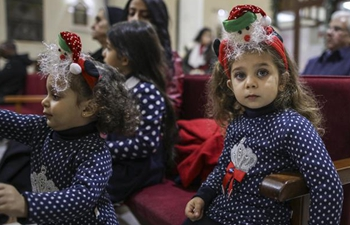 Palestinians attend last Sunday mass before Christmas
