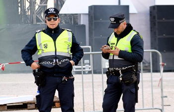 Policemen guard at Comercio square prior to New Year eve concert in Lisbon