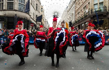 Performers parade during annual New Year's Day Parade in London