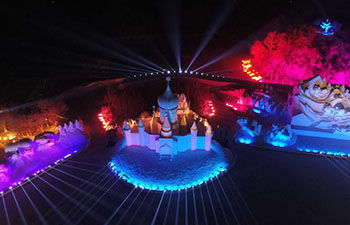 3D snow-light show held at Sun Island Int'l Snow Sculpture Art Expo