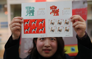 Chinese design legend creates stamps for Year of the Dog