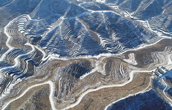 Snow scenery of terraced fields in north China's Hebei
