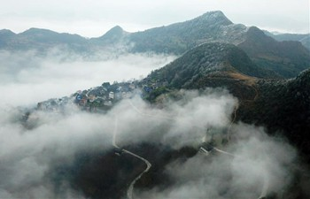 Sea clouds seen over Miao village in SW China
