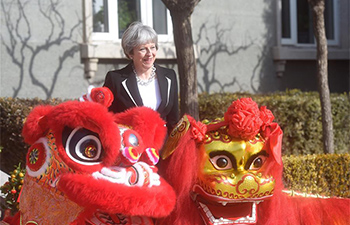 May attends cultural reception accompanied by British ambassador in Beijing