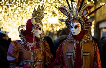 Costumed revelers gather for Venice Carnival