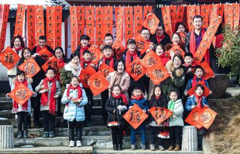 Migrant workers take part in folk activities with their children in China's Zhejiang