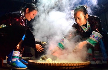 Women of Miao ethnic group make traditional festive drinking