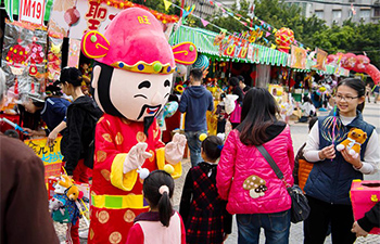 People do Spring Festival shopping in Macao for Chinese Lunar New Year