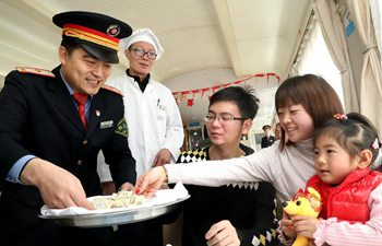 Attendants deliver free dumplings to passengers on train in E China