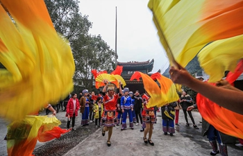 People dance to spend Spring Festival in central China's Hunan