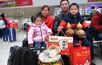 People on journey after Spring Festival holiday with hometown taste