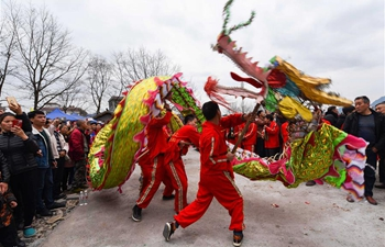 Villagers perform dragon dance in Guizhou to greet Spring Festival