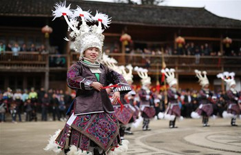 Miao people dance to celebrate coming of spring in SW China's Guizhou